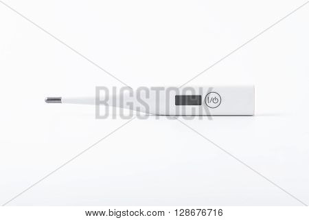 clinical thermometer on white background . .
