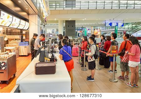 HONG KONG - SEPTEMBER 09, 2015: McDonald's restaurant at Hong Kong International Airport. McDonald's is the world's largest chain of hamburger fast food restaurants, founded in the United States.