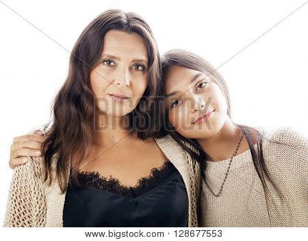 cute pretty teen daughter with real mature mother hugging, fashion style brunette makeup close up tann mulattos, warm colors isolated on white background