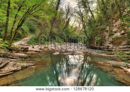 Agura River in mountain forest in Sochi Russia. HDR processing