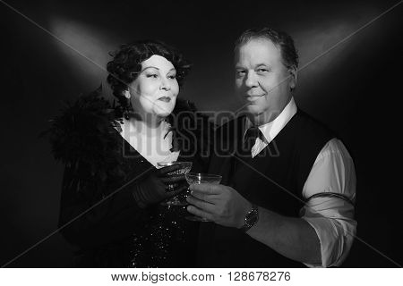 Vintage 1940S Couple Holding Glass Of Champagne. Classic Black And White Portrait.