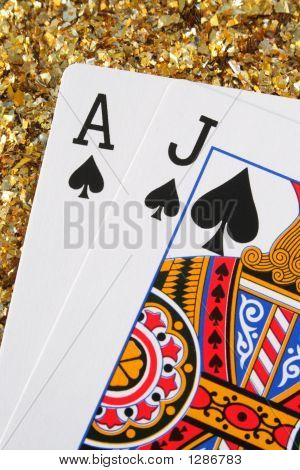 Blackjack/Pontoon Cards With A Gold Glitter Background.