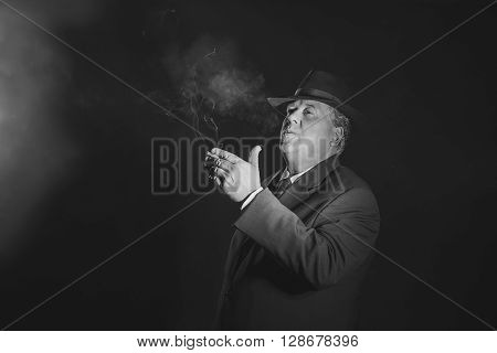 Retro 1930S Gangster Smoking Cigar. Classic Black And White Portrait.