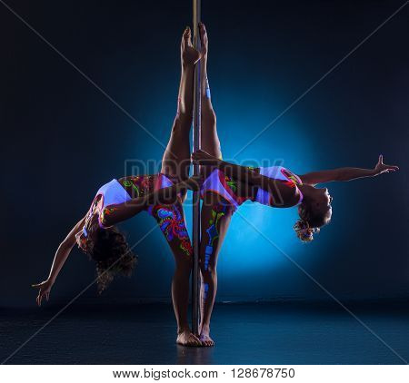 Flexible girls posing symmetrically doing gymnastic splits