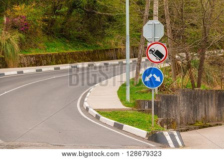 Turn on mountain road leading up with road signs