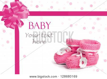 Cute wolen baby shoes on white background