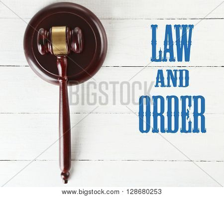 Gavel on wooden background. Law and order concept