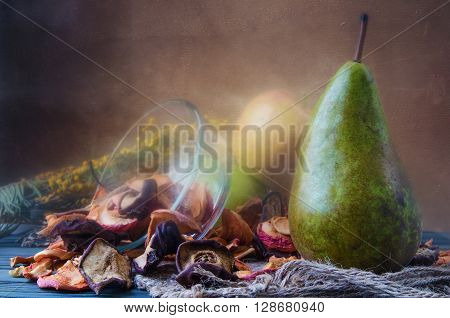Still life with dried fruits from apples and pears thorough inspection