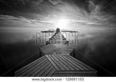 Zig Zag dock at sunrise in Santiago de La Ribera, Mar Menor, Murcia