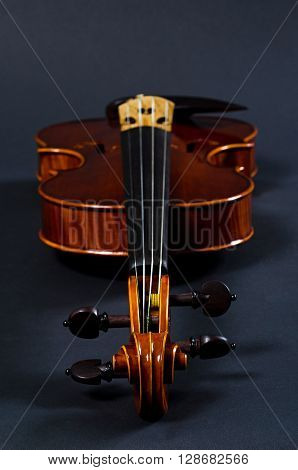 view of old wooden violin on black background