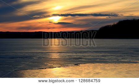 Beautiful photo of the amazing sunset on the icy lake