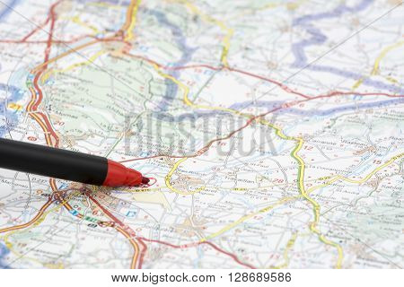 red pen marking the tourist destination on a map