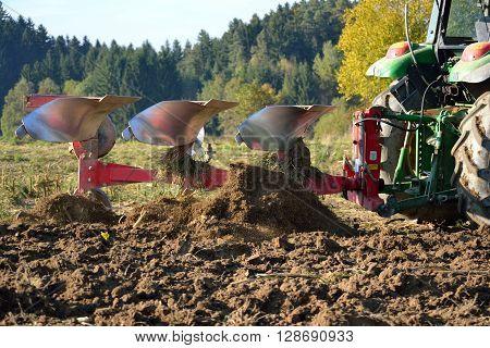 Farmer plows his field - closeup farming