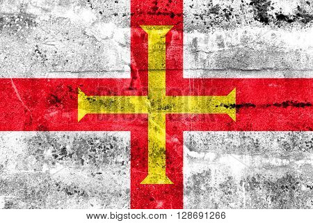Flag Of Guernsey, Painted On Dirty Wall. Vintage And Old Look.