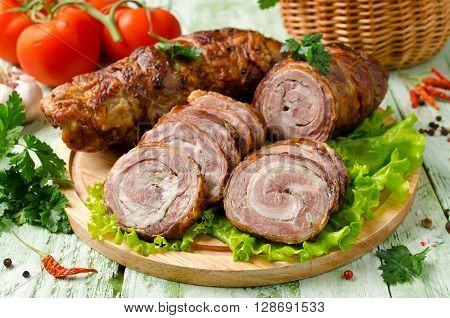 Meat loaf roll with garlic and pepper. Sliced roasted meatloaf