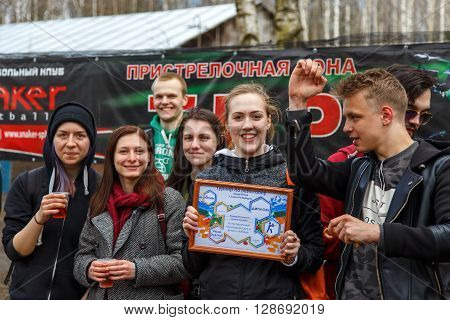 Saint-Petersburg, Russia - April 24, 2016: Paintball tournament in Snaker club between student teams from five universities. Group photo.