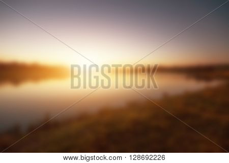 Blurry image of sunset over the lake