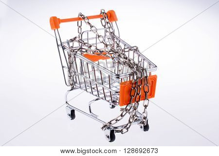 A chained shopping cart in white background