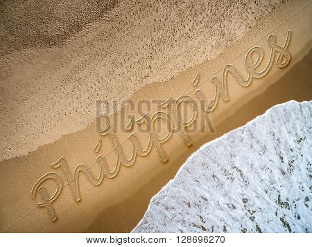 Philippines written on the beach