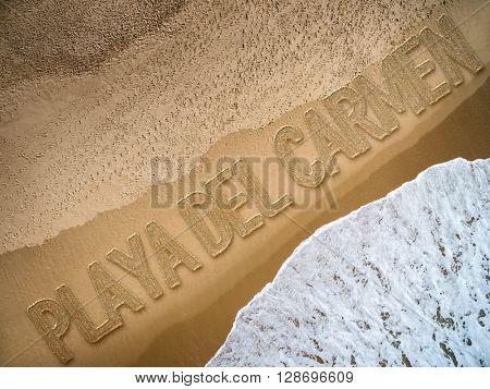 Playa del Carmen written on the beach