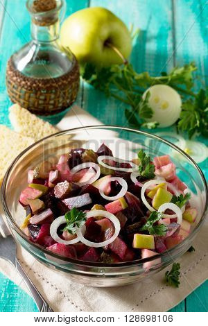 Salad With Herring And Vegetables (pickled Cucumber, Beetroot, Apple), Filled With Vegetable Oil.