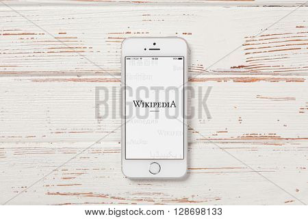 WROCLAW, POLAND - APRIL 12, 2016: Apple iPhone SE smartphone with Wikipedia app on screen