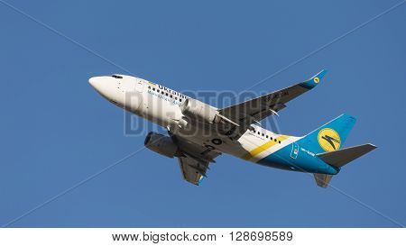 Moscow - August 20 2015: A passenger plane Boeing A319 Ukraine International Airlines Airlines takes off at the airport Domodedovo and blue sky August 20 2015 Moscow Russia