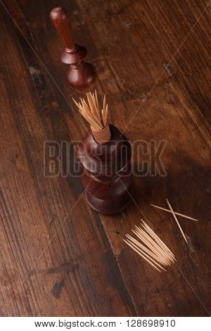 Compartment for toothpicks over a wooden table