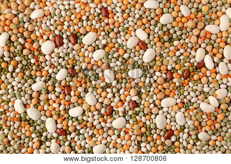 Variety of coloured beans and lentils. Food background