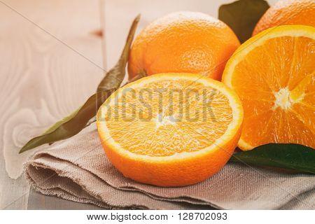 sliced orange on wood table, viontage toned