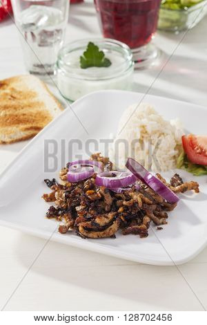 gyros meat on a plate with wine