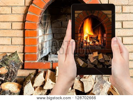 Tourist Photographs Fire In Fireplace On Tablet Pc