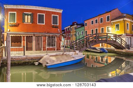 Bridge across canal in the evening on Burano island Venice Italy