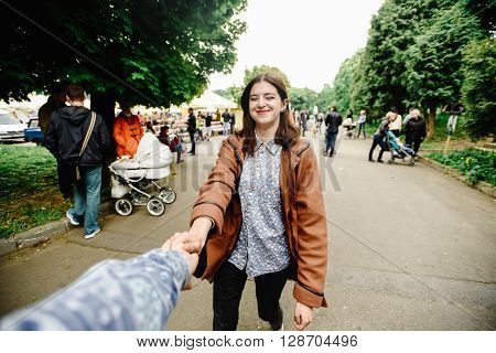 Stylish Happy Hipster Girl Holding Hand With Boyfriend, Follow Me And Travel Together Concept