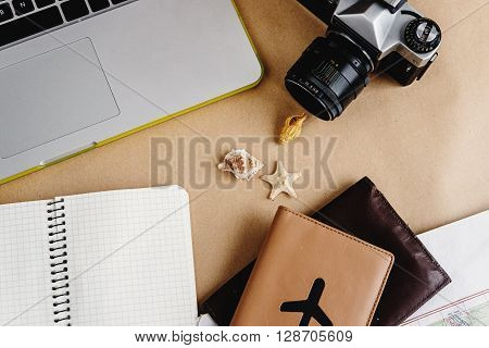 Time To Plan Travel Concept, Stylish Passport With Plane, Map Watch And Camera On Craft Background