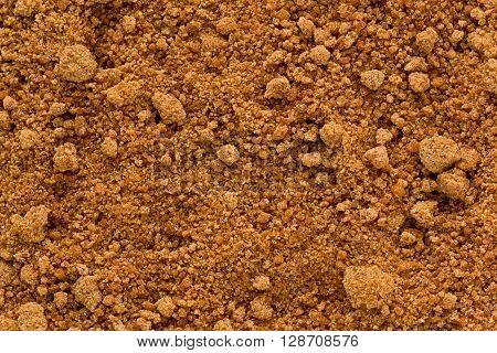 Background texture of organic coconut sugar also known as coco sap sugar.