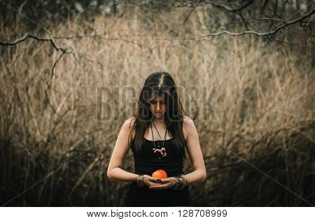 Stylish Beautiful  Brunette Girl In Ethnic Clothes In The Amazing Woods With Apple