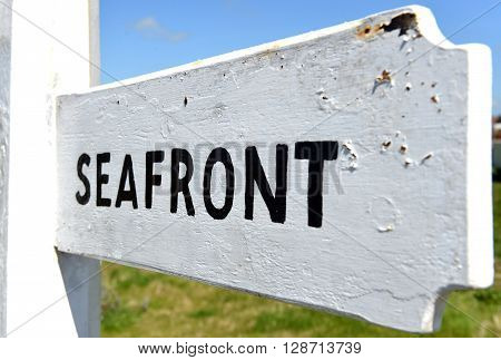 Seafront sign black on white traditional finger post