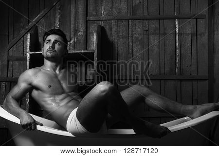 Muscular Man On Bathtub