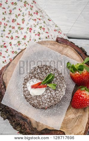 Chocolate belgian waffles with strawberries whipped cream and mint leaf on wooden table. Top of view with copy space