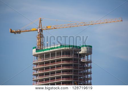 New building under construction with construction crane