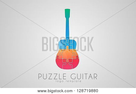 Guitar logo. Puzzle guitar logo design. Creative guitar logo. Music logo.