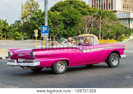 HAVANA - APRIL 27: Vintage car used as taxi in Havana, Cuba on April 27, 2016