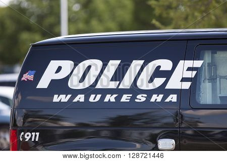 WAUKESHA WI/USA - July 13 2015: A Waukesha police van is parked in front of the Waukesha Convention Center during a progressive political protest against Governor Scott Walker.