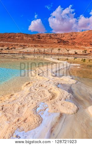 The evaporated salt forms freakish patterns on a water surface. The Dead Sea at coast of Israel