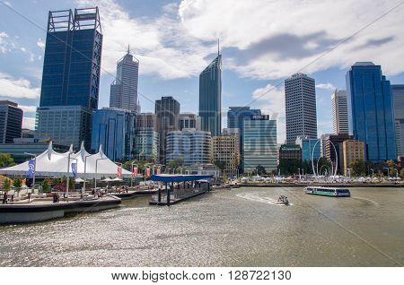 PERTH,WA,AUSTRALIA-APRIL 10,2016: Urban cityscape and artificial inlet at Elizabeth Quay with boating transportation in Perth, Westenr Australia.