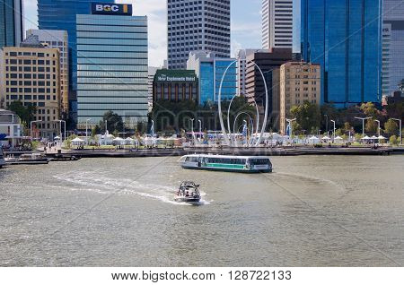 PERTH,WA,AUSTRALIA-APRIL 10,2016: Elizabeth Quay's artificial inlet with foreshore, transperth ferry, boat and tourists fronting the cityscape in Perth, Westenr Australia.