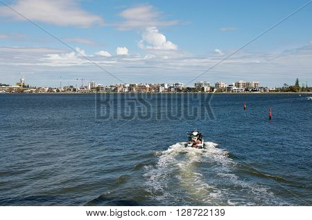 PERTH,WA,AUSTRALIA-APRIL 10,2016: Boating recreation in the Swan River with South Perth views in Perth, Western Australia.