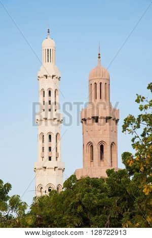 Two minarets at Sultan Qaboos Grand Mosque in Muscat the main mosque of The Sultanate of Oman.