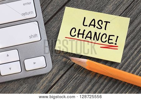 last chance alert note with desk background